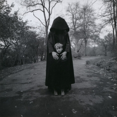 Young Boy and Hooded Figure - New York, 1971